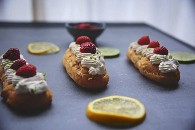 Gluten-free lemon earl grey eclairs   Filled with lemon lime curd and topped with earl grey whipped cream   on Due fili d'erba   Two blades of grass   Thais FK   Background by Florim Ceramiche   Bowl by Broste Copenhagen