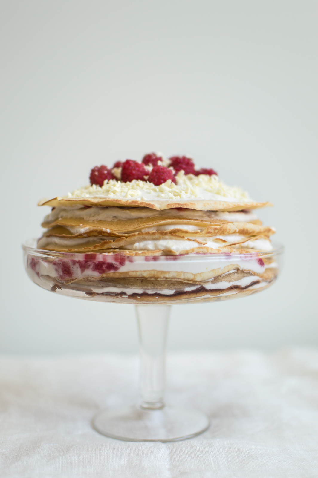 Crepe cake with Coconut White Chocolate Cream & Raspberry sauce   on Due fili d'erba   Two Blades of Grass   Recipe, photos and styling by Thais FK